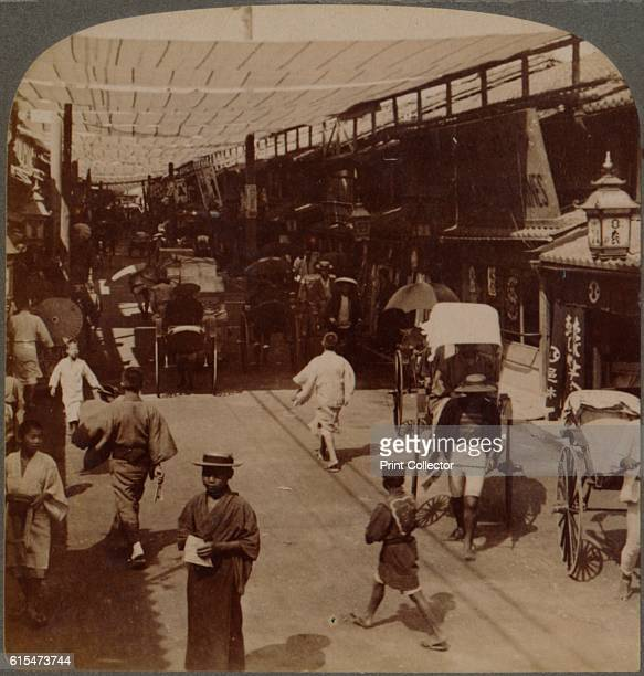 Midsummer traffic under awnings of Shirobashidori a busy thoroughfare of Kyoto Japan' 1904 From The Underwood Travel Library Japan [Underwood...