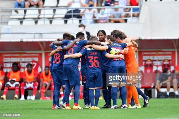 Midtjylland players gather together before the friendly match between Reims and FC Midtjylland at Stade Auguste Delaune on August 15, 2020 in Reims,...