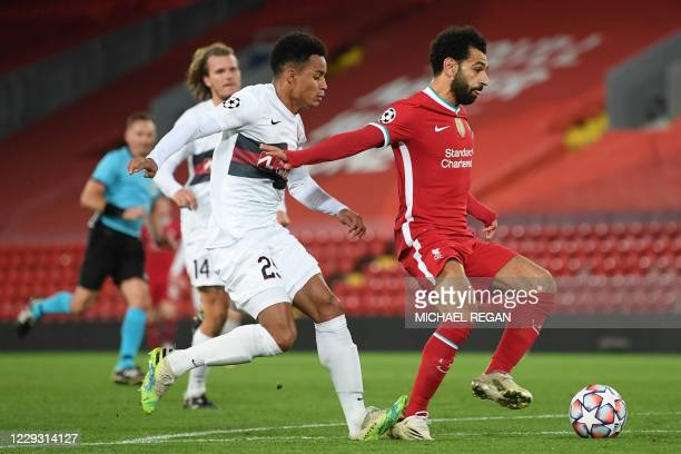 Midtjylland's Brazilian defender Paulinho fouls Liverpool's Egyptian midfielder Mohamed Salah for a penalty during the UEFA Champions league Group D...