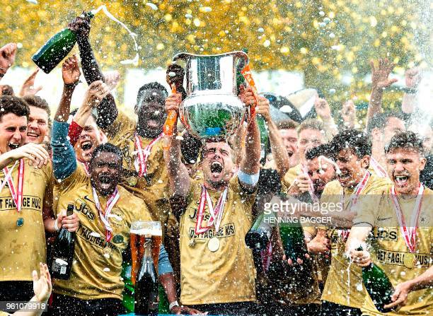 FC Midtjylland's captain Jakob Poulsen and his teammates celebrate with the cup after the club won the Danish championship after beating AC Horsens...