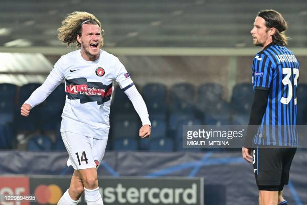 Midtjylland's Danish defender Alexander Scholz celebrates after opening the scoring during the UEFA Champions League Group D football match Atalanta...