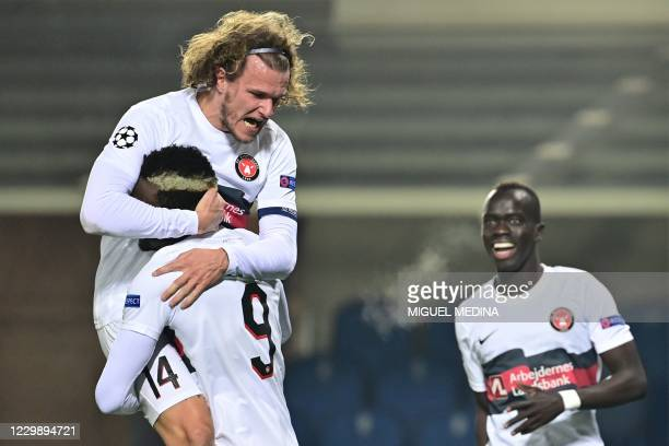 Midtjylland's Danish defender Alexander Scholz celebrates with Midtjylland's Guinean forward Sory Kaba after opening the scoring during the UEFA...
