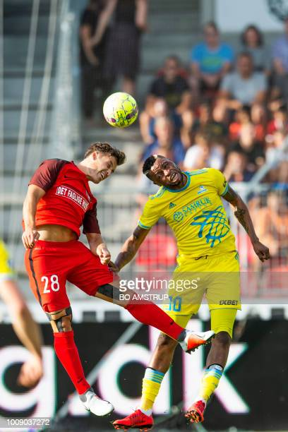 Midtjylland's Erik Sviatchenko and Astana's Junior Kabananga vie for the ball during the UEFA Champions League second round second leg qualifying...