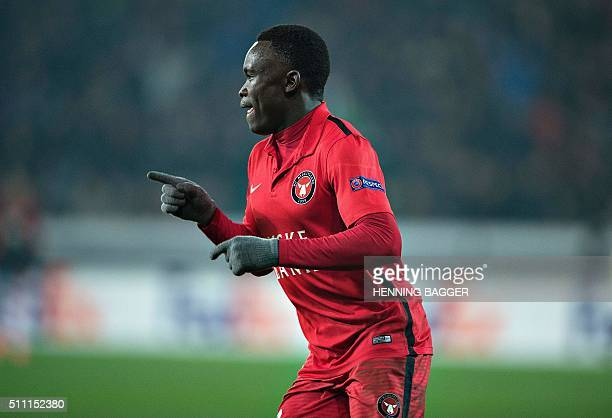 FC Midtjylland's forward Pione Sisto celebrates scoring the 11 goal during the UEFA Europa League Round of 32 football match between Manchester...