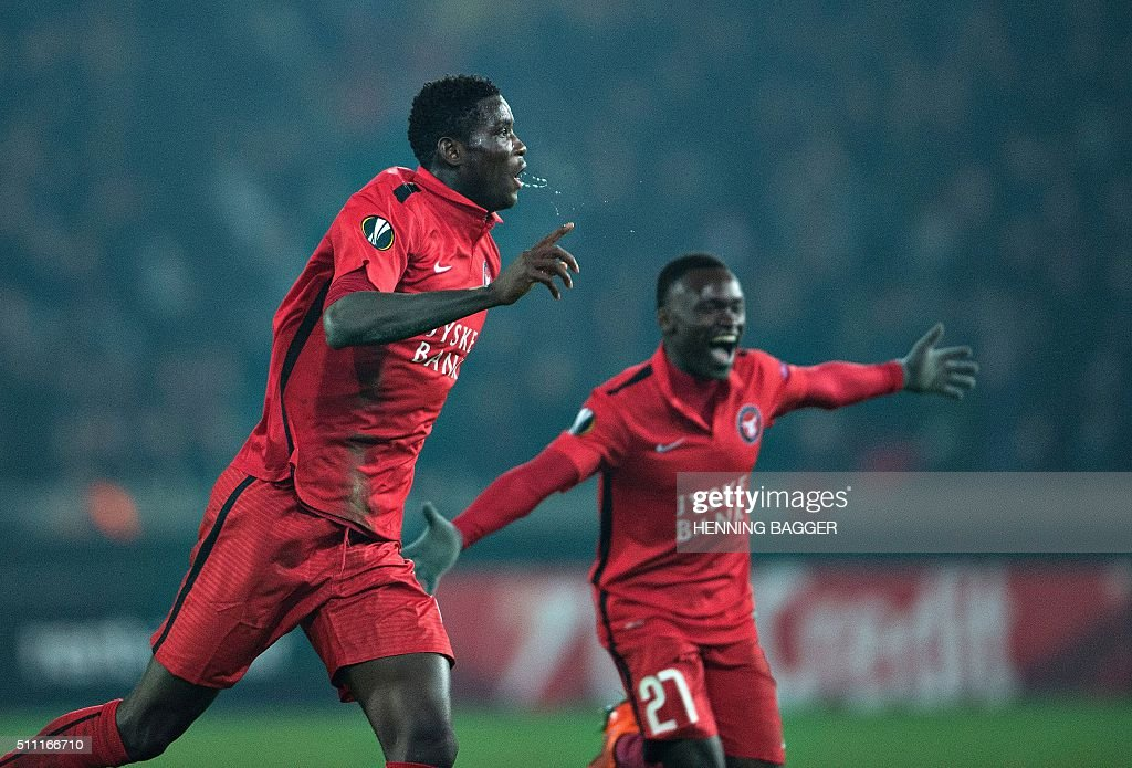 FC Midtjylland's Nigerian forward Paul Onuachu celebrates scoring their second goal during the UEFA Europa League Round of 32 football match between Manchester United and FC Midtjylland in Hernin on February 18, 2016. / AFP / Scanpix Denmark / Henning Bagger / Denmark OUT