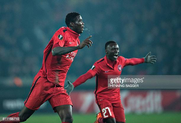FC Midtjylland's Nigerian forward Paul Onuachu celebrates scoring their second goal during the UEFA Europa League Round of 32 football match between...
