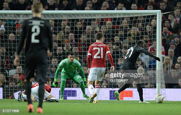 FC Midtjylland's Ugandan forward Pione Sisto shoots to score his teams first goal during the UEFA Europa League round of 32 second leg football match...