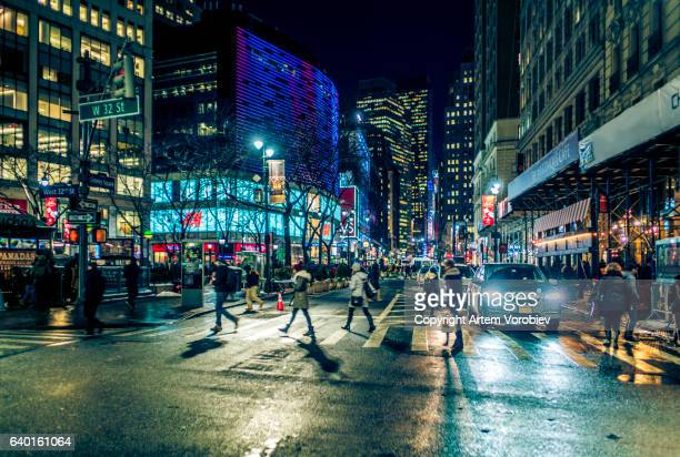 midtown manhattan at night - broadway manhattan stock photos and pictures