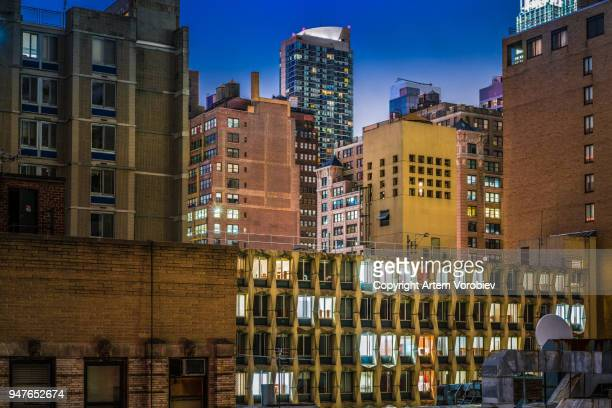 midtown manhattan at night - chelsea new york stock photos and pictures