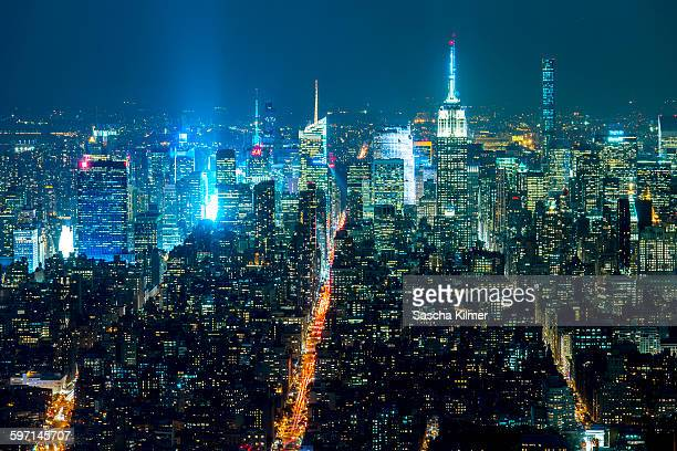 midtown manhattan by night - sixth avenue stock pictures, royalty-free photos & images