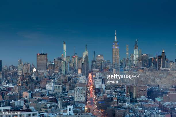 midtown manhattan cityscape at dusk - sixth avenue stock pictures, royalty-free photos & images