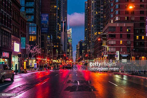 midtown manhattan in the evening - chelsea new york stock photos and pictures
