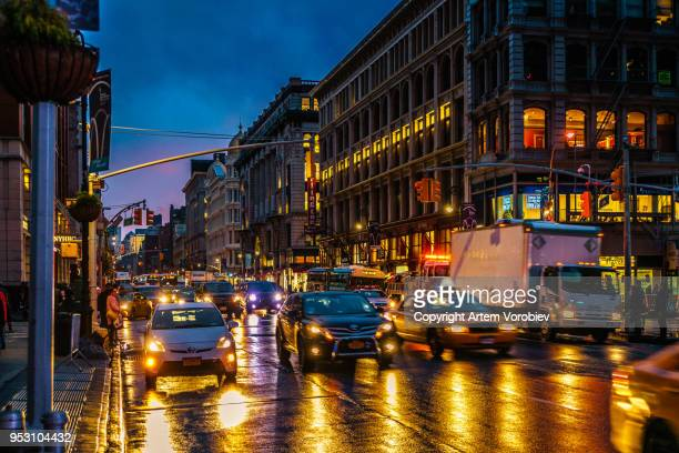 midtown manhattan in the evening - sixth avenue stock pictures, royalty-free photos & images