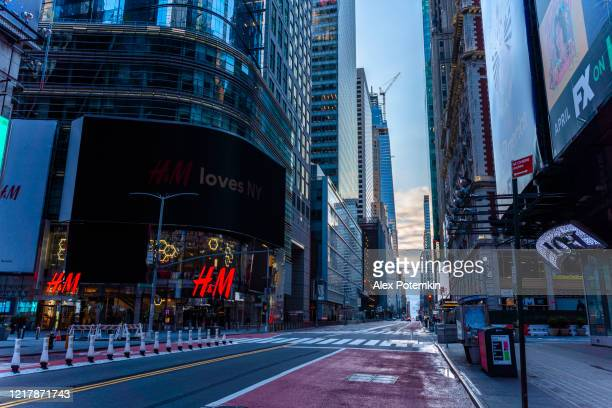 midtown manhattan, normally overcrowded by people and traffec, is now deserted even in the morning rush hours because of the city lockdown caused by covid-19 pandemic. - modern essentials by h&m stock pictures, royalty-free photos & images