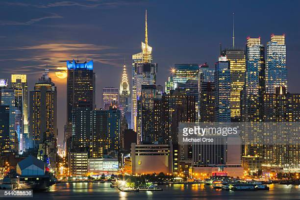 Midtown Manhattan NYC skyline at night. Viewed from New Jersey. Full, Super moon.
