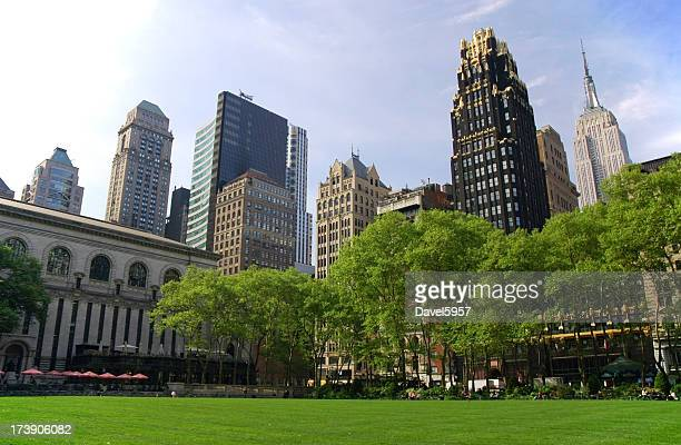 midtown manhattan skyscrapers and bryant park - bryant park stock pictures, royalty-free photos & images
