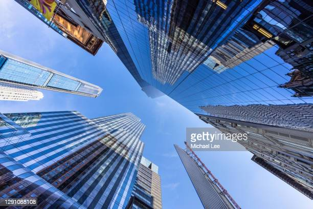 midtown manhattan skyscrapers - new york - new york city stock pictures, royalty-free photos & images