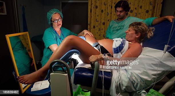 A midwife assists Jessica Moreno as she gives birth at the University Hospital Virgen de la Candelaria of Santa Cruz de Tenerife on the Spanish...