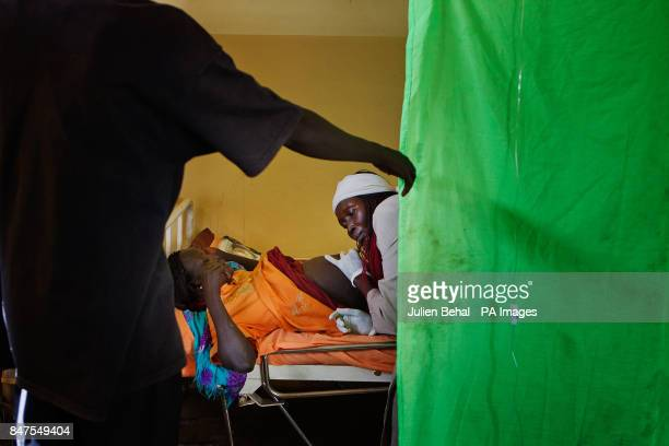 A midwife examines a woman about to give birth in the Goal sponsored clinic in BunjMaban in the Upper Nile Blue Nile state of northeastern South...