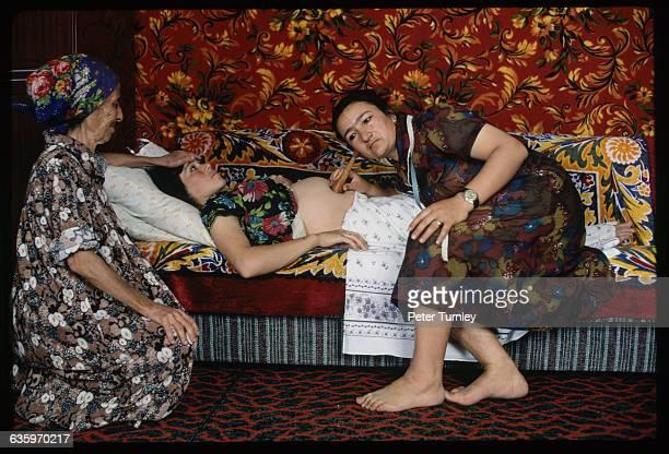 Midwife Examining a Pregnant Woman