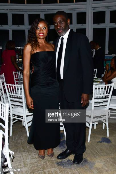 Midwin Charles and Dr Henry Paul attend the NOAH NY 10th Anniversary Gala at Brooklyn Botanic Gardens on May 22 2019 in New York City