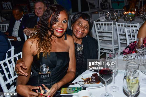 Midwin Charles and Mother attend the NOAH NY 10th Anniversary Gala at Brooklyn Botanic Gardens on May 22 2019 in New York City