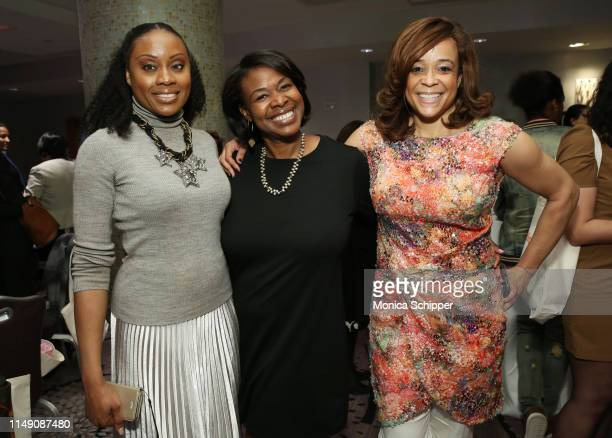 Midwin Charles Diana St Louis and Kwanza R Butler attend the reception for the 32nd Anniversary Celebrating Women Breakfast at Marriott Marquis on...