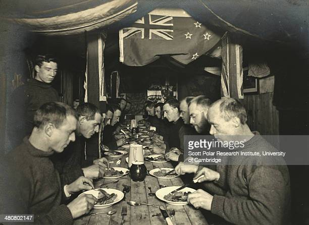 Midwinter dinner on the 'Endurance' 22nd June 1915 during the Imperial TransAntarctic Expedition 191417 led by Ernest Shackleton The flag of New...