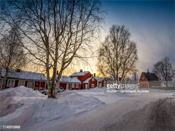 a mid-winter street view in the historic village of gammelstaden, near lulea, northern sweden. - norrbotten province stock pictures, royalty-free photos & images
