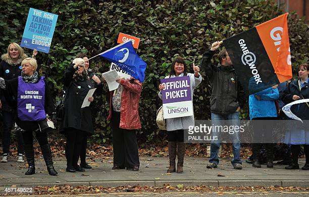 Midwives take part in a strike at the Liverpool Women's Hospital in Liverpool north west England on October 13 2014 Workers in England's staterun...