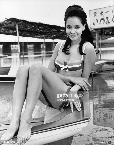 Mie Hama sitting in a boat wearing a bikini in a scene from the film 'You Only Live Twice' 1967