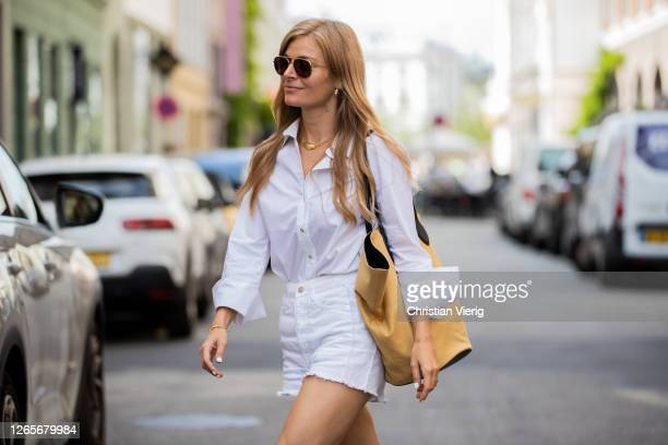 Mie Jul is seen wearing white shorts, button shirts, yellow bag outside Skall Studio during Copenhagen Fashion Week Spring/Summer 2021 on August 12,...