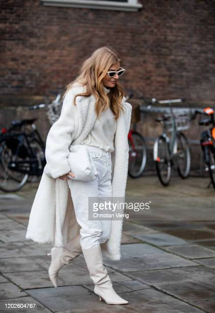 Mie Jul seen wearing white coat, clutch, pants, boots outside Lovechild on Day 1 during Copenhagen Fashion Week Autumn/Winter 2020 on January 28,...