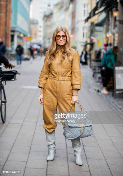 Mie Jul wearing beige overall oversized Chanel bag boots outside Mark Kenly Domino Tanduring Copenhagen Fashion Week Autumn/Winter 2020 Day 2 on...