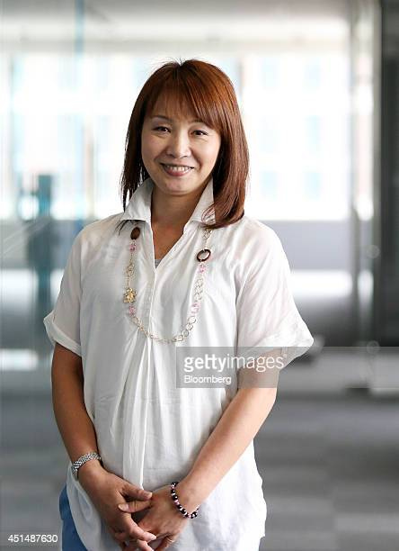 Mie Kurosaka an executive officer of Rakuten Inc poses for a photograph after an interview in Tokyo Japan on Friday June 20 2014 As one of Rakuten's...