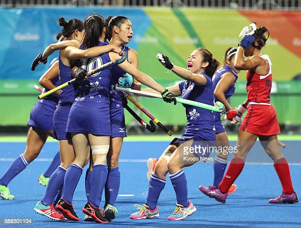 Mie Nakashima celebrates with teammates after scoring a goal in the final quarter of a qualification match against the United States at the Rio de...