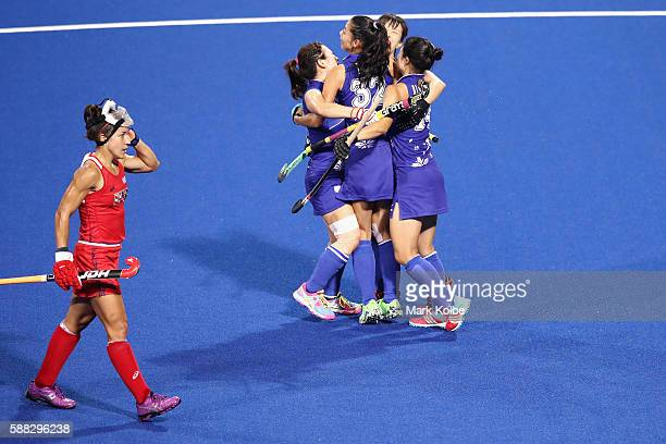 Mie Nakashima of Japan celebrates with her team mates after scoring a goal during the women's pool B match between the United States and Japan on Day...