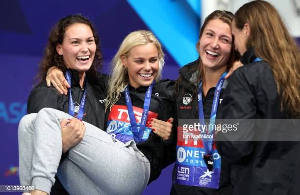 Mie Nielsen Rikkie Moeller Pedersen Emilie Beckmann and Pernille Blume celebrate their silver medal in the women's 4x200m medley relay during the...