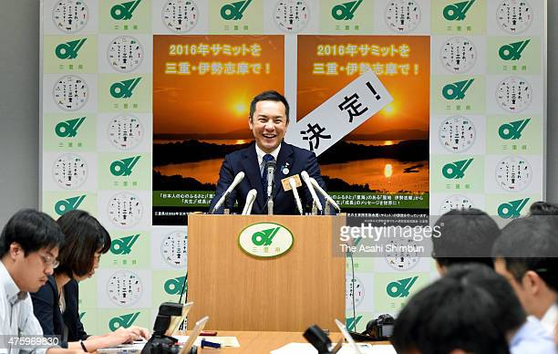 Mie Prefecture Governor Eikei Suzuki smiles during a press conference after Prime Minister Shinzo Abe announcing the 2016 Summit will be held in...