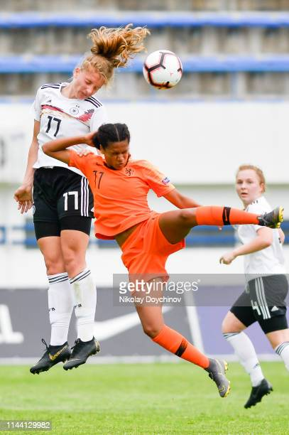 Mieke Schiemann of Germany jumps for the ball during the 2019 UEFA Women's Under17 EURO final maEsmee Brugtstch between Netherlands and Germany at...