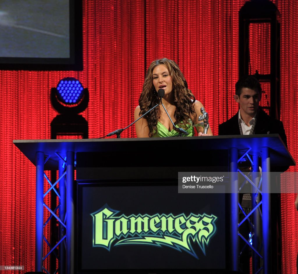 Miesha Tate accepts the Female Fighter of the Year Award at the 2011 Fighters Only World Mixed Martial Arts Awards at the Palms Casino Resort on November 30, 2011 in Las Vegas, Nevada.