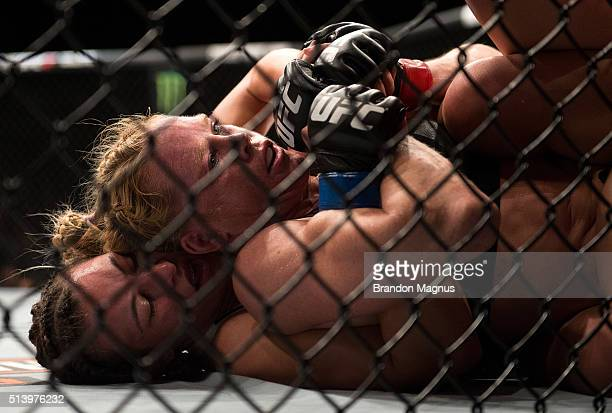 Miesha Tate attempts to submit Holly Holm during their women's bantamweight championship bout during the UFC 196 in the MGM Grand Garden Arena on...