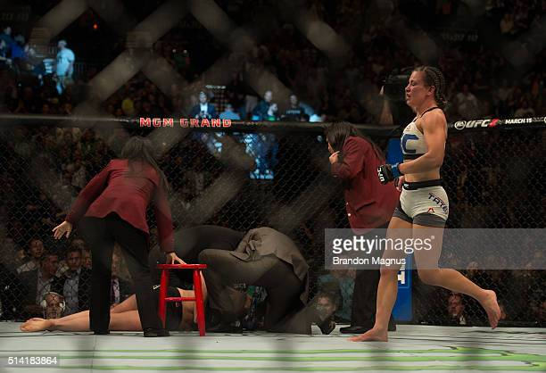 Miesha Tate celebrates her submission victory over Holly Holm after their women's bantamweight championship bout during the UFC 196 in the MGM Grand...