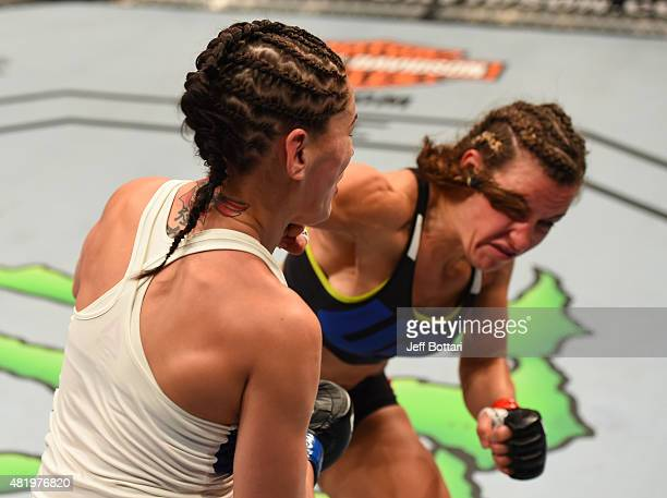 Miesha Tate drops Jessica Eye with a punch in their women's bantamweight bout during the UFC event at the United Center on July 25 2015 in Chicago...