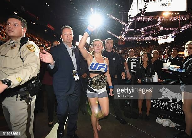 Miesha Tate exits the Octagon after defeating Holly Holm during the UFC 196 event inside MGM Grand Garden Arena on March 5 2016 in Las Vegas Nevada