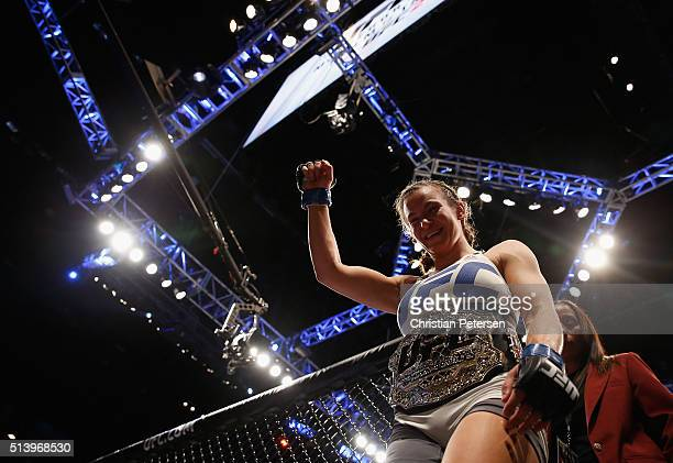 Miesha Tate exits the Octagon after defeating Holly Holm in their UFC women's bantamweight championship bout during the UFC 196 event inside MGM...