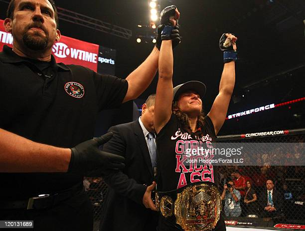 Miesha Tate is victorious over Marloes Coenen to capture the Women's Bantamweight Championship at the Strikeforce event at Sears Centre Arena on July...