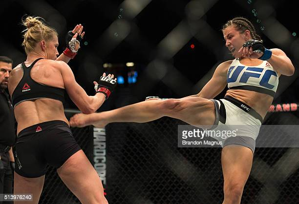 Miesha Tate kicks Holly Holm during their women's bantamweight championship bout during the UFC 196 in the MGM Grand Garden Arena on March 5, 2016 in...