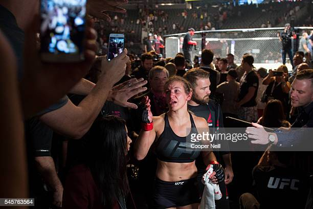 Miesha Tate leaves the Octagon after losing to Amanda Nunes during UFC 200 at TMobile Arena on July 9 2016 in Las Vegas Nevada