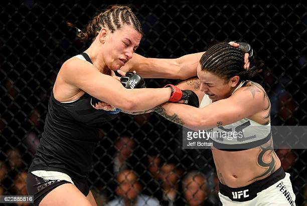 Miesha Tate of the United States fights against Raquel Pennington of the United States in their women's bantamweight bout during the UFC 205 event at...